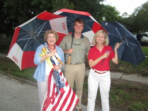 Commissioner Murman stands with Julie Whitney and Chris Whitney during 9-11 Memorial