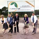 Sandy helps break ground for The Giunta Group's latest project, Citrus Run Apartments on West Waters Avenue. From left are Paul Bauman, Gloria Giunta, Richard Giunta, Sam Ellison, Commissioner Mark Sharpe and Casey Ellison.
