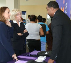 Commissioner Murman speaks with Darius Kelley of FedEx, one of 30 employers at her South County Job Fair; nearly 250 people attended the event