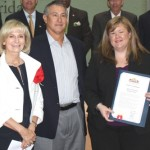 Sandy honors the Judeo Christian Health Clinic for its 40 years of service; Executive Director Kelly Bell and Board Secretary Frank John Garcia accepted at the BOCC