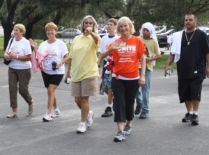 Sandy walks with members of the community and Public Defender Julianne Holt at the Mendez Foundation Too Good For Drugs Walk & Kids Fest held at MOSI