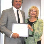 """Commissioner Murman presents Port Board Member Steve Swindal of Marine Towing Swindal with a """"You Make a Difference"""" plaque for service to Port Tampa Bay."""
