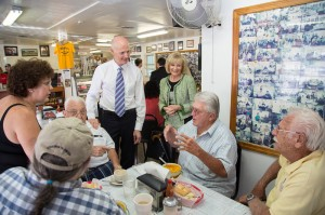 Commissioner Sandy Murman and Florida Governor Rick Scott listen to residents during lunch at the West Tampa Sandwich Shop.