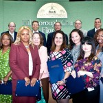 Commissioner Murman proclaims Back to School Readiness Month. School Board Member Susan Valdez, Martine Dorvil of the UACDC and Cindy Morris of the Department of Health and many partners were on hand to accept the proclamation.
