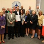 Sandy presents the Small Business Week proclamation before the BOCC.