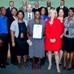 The full staff for Hillsborough County's Sunshine Line program and Director Ed Wisniewski stand with Sandy after receiving a commendation for stellar work while serving as the transportation system for the disadvantaged in the County.