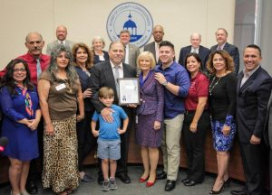 Commissioner Murman recognizes Tony Morejon at a BOCC meeting.
