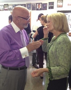 Sandy talks with Tampa City Council Chairman Charlie Miranda during a lunch with Governor Scott at the West Tampa Sandwich Shop.