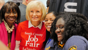Sandy takes time with Amazon staff at her South County Job Fair held at HCC SouthShore. Amazon was hiring for hundreds of positions along with 40 other employers.