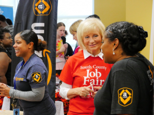 Sandy speaks with Amazon staff at her 2014 South County Job Fair