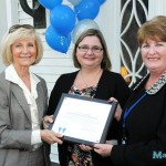 "Sandy presents a ""You Make a Difference"" award to Katie Everlove-Stone, and Ann Madsen, of The Centre for Women in honor of the opening of the Helen Gordon-Davis Women's Business Center."