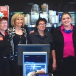 Sandy paused for a picture with the crew of the McDonald's on U.S. 41 in Ruskin during her Coffee event.