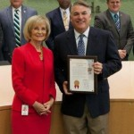 Sandy recognizes Port Tampa Bay on its 70th Anniversary. On hand to receive the honors is Port Director Paul Anderson.