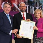 Commissioner Sandy Murman and Paul Anderson present Panama Canal Deputy Administrator Manuel Benítez with a proclamation from the county, proclaiming Panama Canal Appreciation Day.