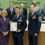 Commissioner Sandy Murman honors MacDill Air Force Base for its 75th Anniversary at a BOCC meeting. On hand for the presentation were Col. Dan Tulley, who commands the 6th Air Mobility Wing at MacDill and Command Chief Matthew Lussen.