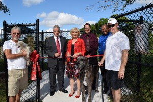 "Sandy led the ""Unleashing Ceremony"" for the Northwest County Dog Park, along with community partners Joe Odda from Westchase, Jeff Seward from HART, Dexter Barge from Hillsborough County and many area residents."