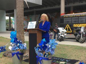 Commissioner Sandy Murman announces the Children's Museum Pinwheels for Prevention Program.