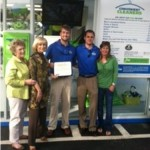 Sandy recognizes Convenient Cleaners at a recent ribbon-cutting ceremony. Owners Chris Whitney and Ryan Reynolds grew up in Tampa and are pictured here with Sandy and their moms