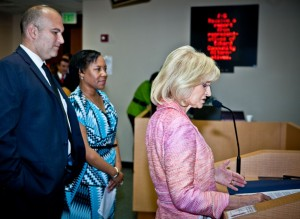 """Sandy proclaimed """"Walk a Mile for a Child in Foster Care Day"""" at a County Commission Meeting. Eckerd Community Alternatives Advisory Council member Dan Jurman and Director of Programming, Lesa Sims accepted the proclamation."""