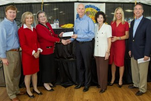 Commissioner Sandy Murman is on hand with The Children's Home Board Chair, Carolyn Harbert for a presentation from Governor Rick Scott and CFO Jeff Atwater at the State Fair. From left are: Agriculture Commissioner Adam Putnam, Sandy, Ms. Harbert, Gov. Scott, Mary Lu Kiley, CFO for The Children's Home, Attorney General Pam Bondi and CFO Atwater.