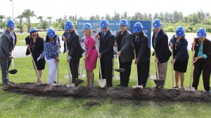 Sandy takes part in the groundbreaking ceremony for the new Science & Technology building for HCC SouthShore, along with campus president Dr. Allen Witt, and HCC President Dr. Ken Atwater.
