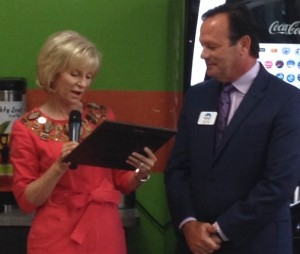 Sandy presents Metropolitan Ministries' Tim Marks with a special plaque commemorating the opening of the second Inside Box cafe on Westshore Blvd.