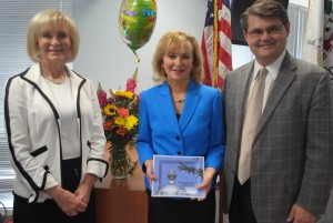 Commissioner Sandy Murman and Hillsborough County Attorney Chip Fletcher recognize Chief Assistant County Attorney Jennie Tarr for her service to Hillsborough County.