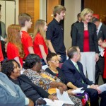 """Commissioner Murman congratulates the Next Radical Generation teen performance group for taking first place in the national """"Say No to Bullying"""" contest, along with Yvonne Fry, the group's producer."""