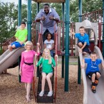 """Sandy and actor Quinton Aaron visit with local children at the Westchase Recreation Center. Aaron, star in the Oscar-award winning film """"The Blind Side,"""" is an advocate of anti-bullying, and is helping Hillsborough County's anti-bullying efforts."""