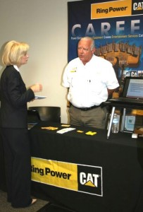 Sandy talks with Noel Schoonmaker of RingPower during her South County Job Fair at the SouthShore Regional Service Center in Ruskin