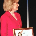 Commissioner Sandy Murman accepts Junior Achievement's National Bronze Leadership Award for her volunteer work with youth in the community.