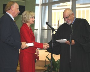 Sandy is sworn in for her second term as the District 1 Hillsborough County Commissioner by Chief Judge Manuel Menendez, Jr. with Jim Murman by her side