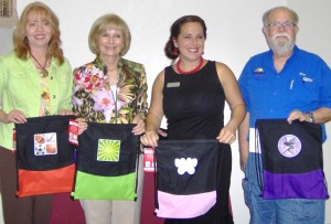 Sandy delivered 150 SackPacks donated by Office Depot to Melanie Morrison, SouthShore Chamber Executive Director, Ron Simpson, Chamber President, at the Chamber's New Teacher Breakfast.