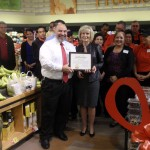 """Sandy presents a """"You Make the Difference"""" award to store manager Rick Rescingo at the Swann Avenue Winn Dixie Ribbon Cutting Ceremony."""