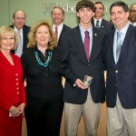 Sandy presented Derek Frantz of Jesuit High School with the Volunteer or Community Service YEA! Youth Excellence and Achievement Award along with his mother and father.