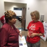 Sandy speaks with Chloe Coney at her recent South County Job Fair at HCC SouthShore Campus.