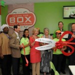 Commissioner Sandy Murman takes time to cut the ribbon for Metropolitan Ministries' second Inside the Box restaurant location on Westshore Blvd.
