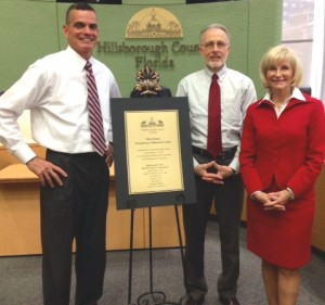 Commissioner Murman and County Administrator Mike Merrill honor outgoing Commissioner Mark Sharpe at his final BOCC meeting.