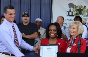 Commissioner Sandy Murman and Commissioner Mark Sharpe present Tampa Hillsborough Homeless Initiative CEO, Antoinette Triplett with a proclamation designating November as Homeless Awareness Month during Operation Reveille, which housed 70 homeless veterans in one day.