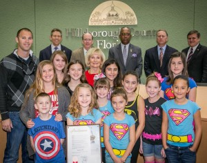 Commissioner Sandy Murman proclaimed February 4th as Superhero Day in Hillsborough County to honor the life of Austin Bradley Coates. On hand were Maria and Brad Coates, April, Aubrie and Brogan Coates, Melanie Morrison, Kate, Roxy and Ginger Morrison, and Leilani Warbritton with Kennedy, Hunter and Jansen Warbritton.