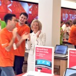 Sandy applauds Microsoft employees during the opening of its new store at International Mall.