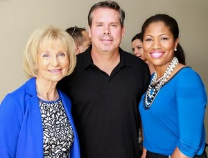 Commissioner Murman takes a moment to visit with Tom Phanco, Chief Operating Officer with CTV Capital, and Estella Gray of the Southwest Florida Water Management District at a ribbon cutting ceremony.