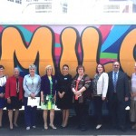 Sandy helps community leaders and county staff launch the MILO (Mobile Interactive Literacy Opportunity) bus to bring books to underserved children in at-risk communities.