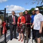 """Sandy led the """"Unleashing Ceremony"""" for the Northwest County Dog Park, along with community partners Joe Odda from Westchase, Jeff Seward from HART, Dexter Barge from Hillsborough County and many area residents."""