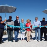 """Sandy Murman, along with members of the Apollo Beach Waterway Improvement Group (ABWIG) and County Parks, took part in a special """"Beach-Towel Cutting"""" to re-open Apollo Beach."""