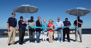 "Sandy Murman, along with members of the Apollo Beach Waterway Improvement Group (ABWIG) and County Parks, took part in a special ""Beach-Towel Cutting"" to re-open Apollo Beach."